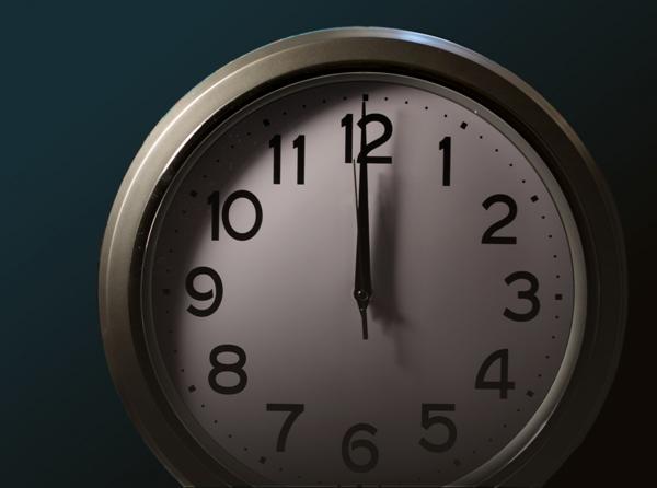 0時を指す時計